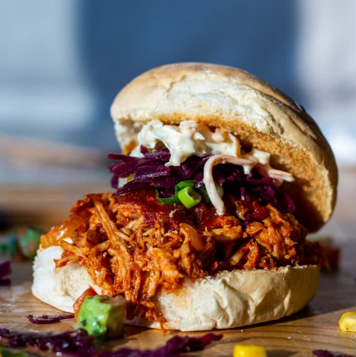 Slow Cokker BBQ Pulled Chicken bun on a board