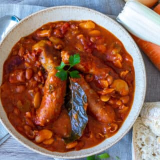 Bowl of Slow Cooker Sausage Cassoulet and vegetables