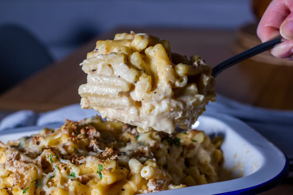 Picture of Slow cooker Macaroni cheese on a spoon.