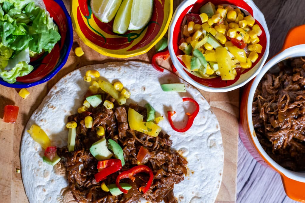 Slow Cooker Spicy Beef Tacos and accompaniments