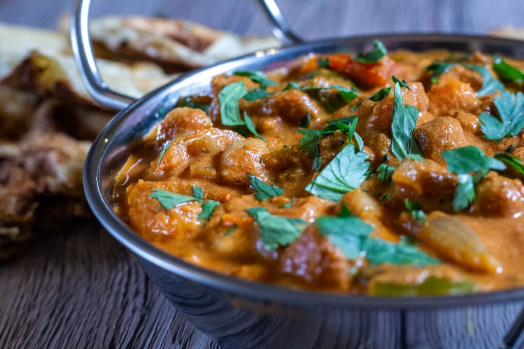 Side view of Slow Cooker Chickpea Curry in a balti dish.