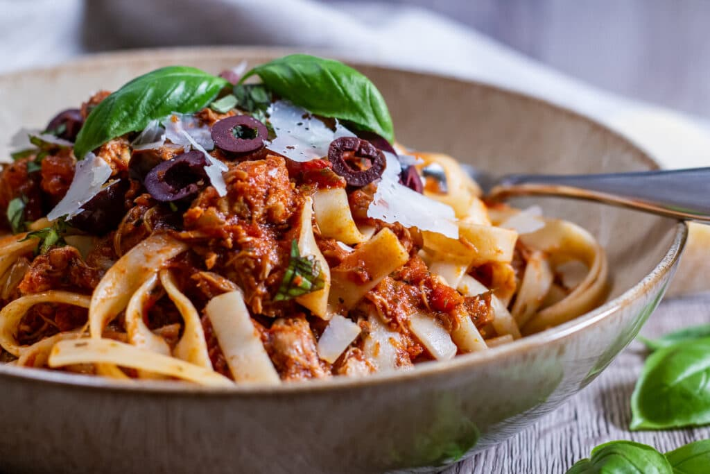 Side view of Slow Cooker Chicken Marinara with pasta.