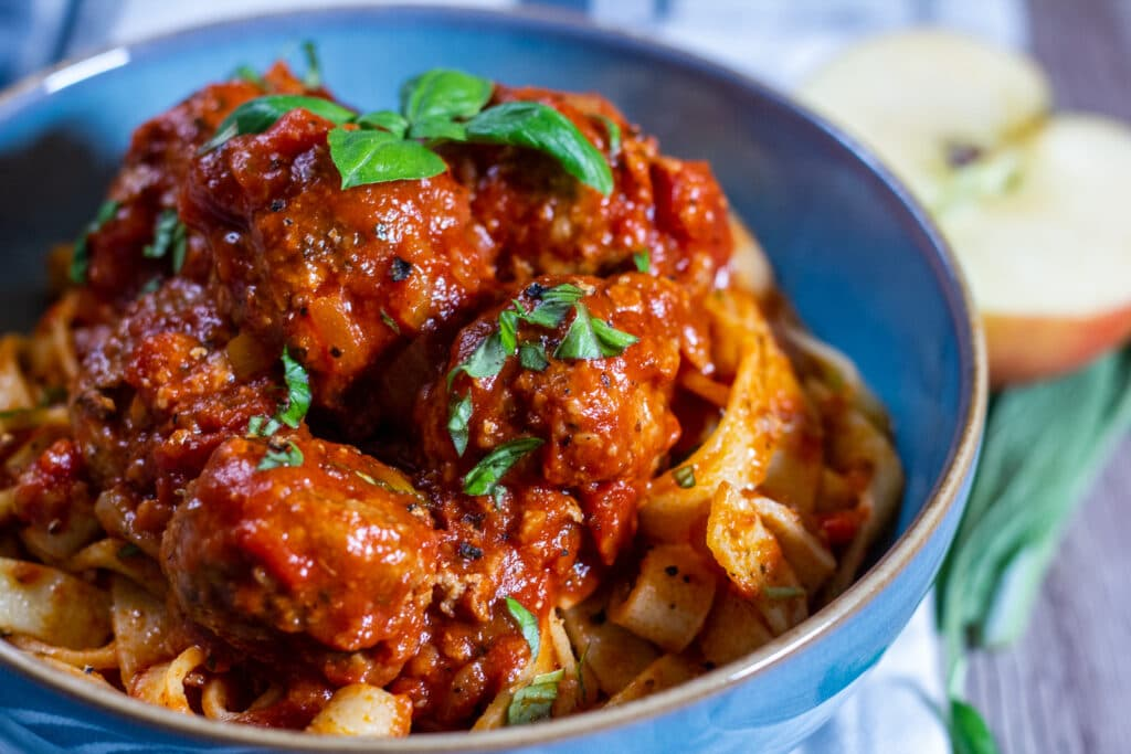 Slow Cooker Pork and Apple Meatballs served with pappardelle pasta