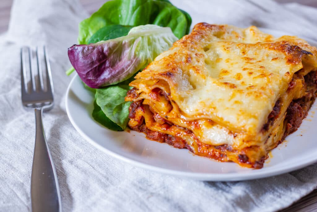 Plate of slow cooker lasagne and salad
