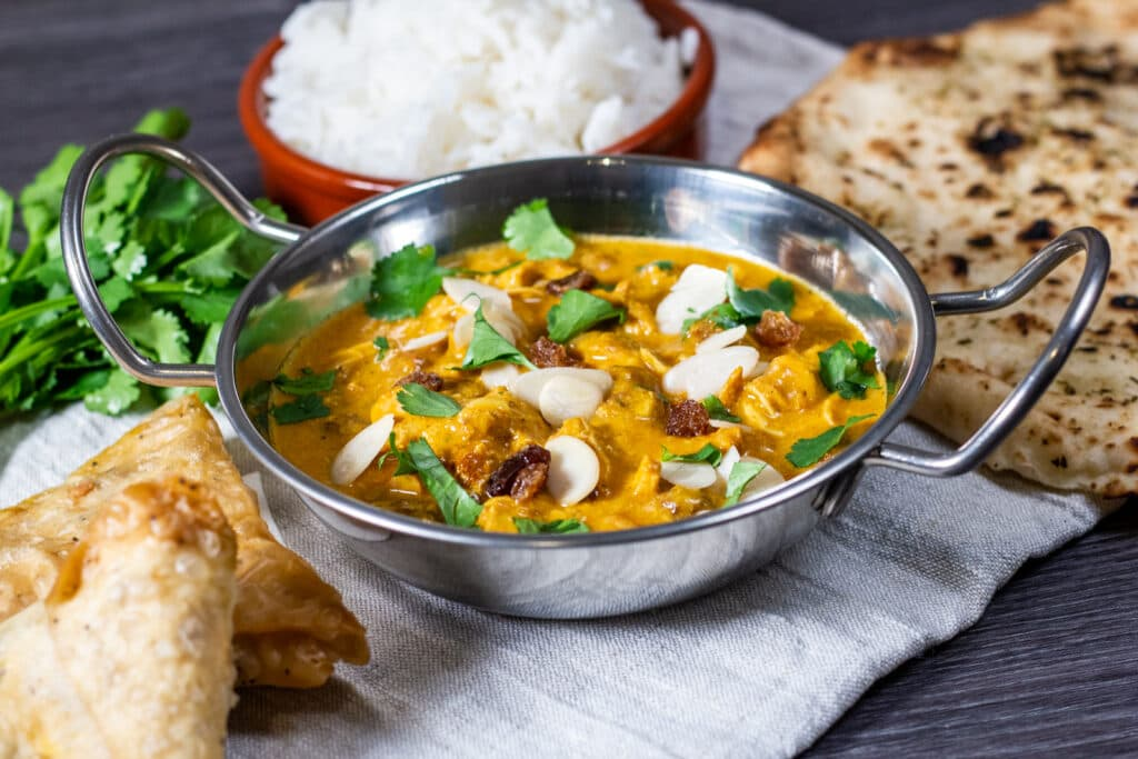Slow Cooker Chicken Korma in a chrome balti dish