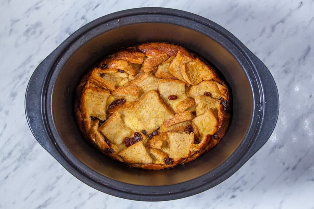 A finished bread pudding cooked in a Crockpot.