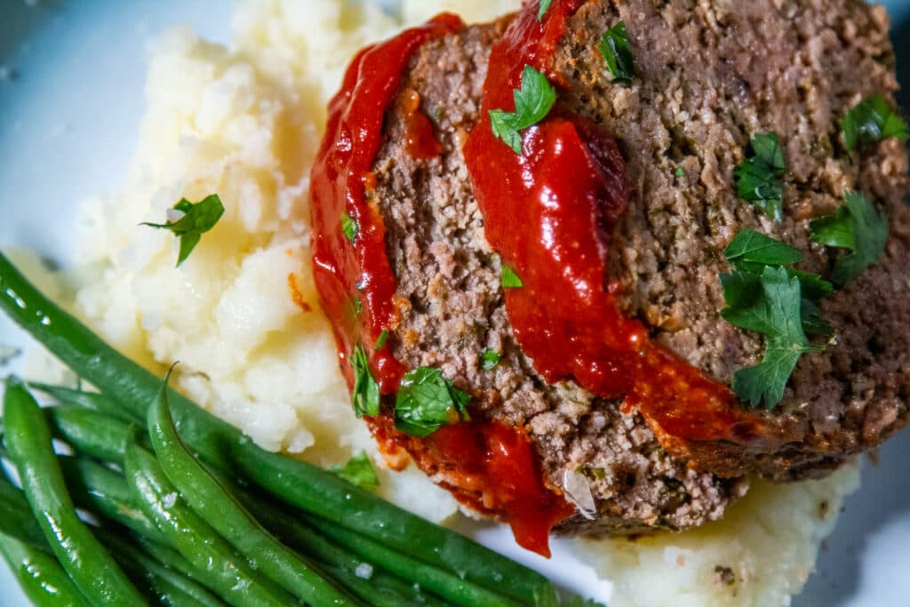 Overhead view of Slow Cooker Meatloaf with potatoes and vegetables.