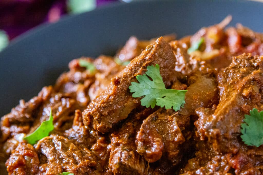 Close up view of Beef Madras curry.