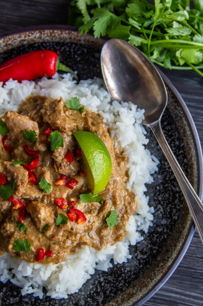 Overhead view of Chicken Satay Curry with rice.