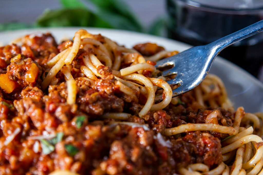 Close up view of Slow Cooker Spaghetti Bolognese on a fork.
